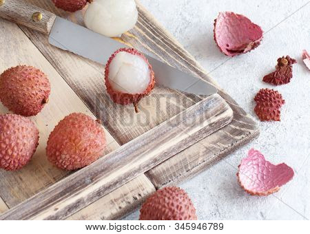 Fresh Litchi Fruits On A Tray In A White Table Close Up