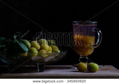 Stilllife With Fresh Yellow Plums And Glass Of Home Made Plum Limonade