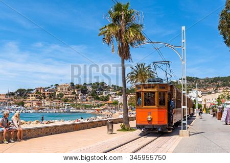 Mallorca, Spain - May 7, 2019: Seafront Promenade With Tram At Port De Soller In Mallorca