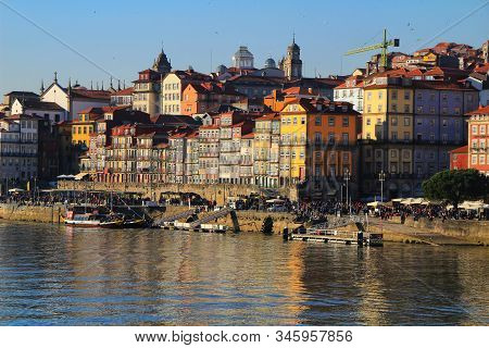 Porto, Portugal- January 7, 2020: Views Of The City Of Porto And The Douro River With Typical Boats