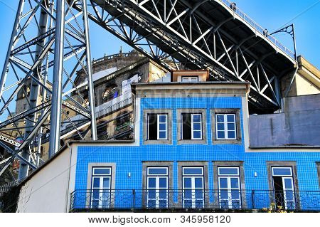 Porto, Portugal- January 5, 2020: Beautiful And Colorful Tiled Facade In Porto City Under The Luis I