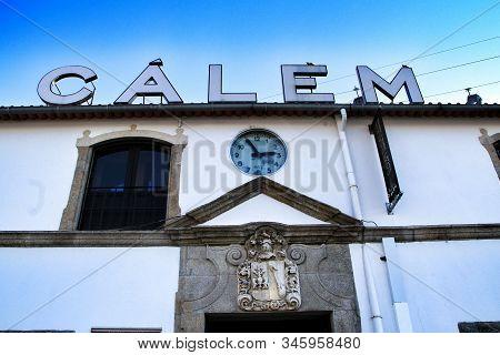 Oporto, Portugal- December 30, 2020: Old Facade Of Port Wine Cellar Called Calem In Vila Nova De Gai