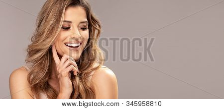 Portrait Of Beautiful Smiling Happy Woman.