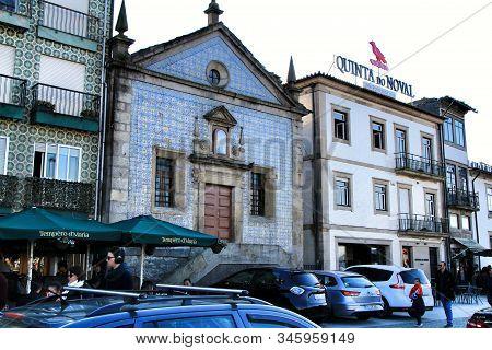 Oporto, Portugal- December 30, 2020: Old Facades Of Port Wine Cellars And Restaurants In Vila Nova D