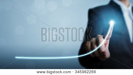 Business Development To Success And Growing Annual Revenue Growth Concept, Businessman Pointing Arro
