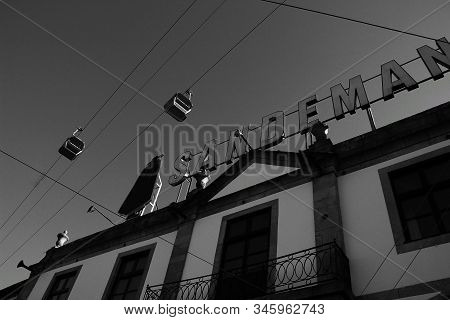 Oporto, Portugal- December 30, 2020: Old Facades Of Port Wine Cellars And Restaurants In Vila Nova D