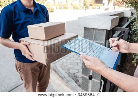 Young Delivery Man Deliver Box Parcel Package And Sending To Customer In Front Of The House, Man Cus