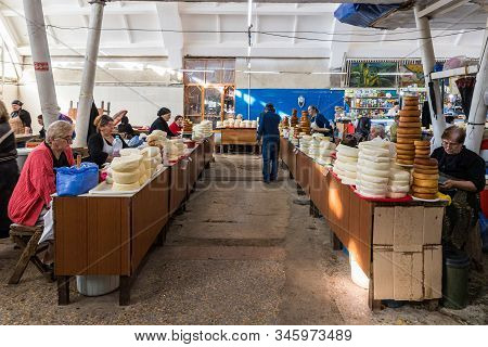 Kutaisi, Georgia, October 13, 2019 : Merchants Sit Near Their Dairy Stalls In The Market In The Old
