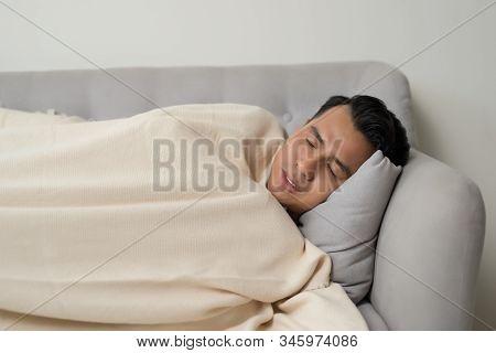 Asian Eldely Sick Man Feel Headache Lying On The Sofa At Home