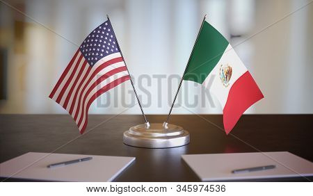 Usa And Mexican Flags On Table. Negotiation Between Mexico And United States. 3d Rendered Illustrati