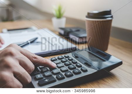 Businessman Working On A Graph Document Financial Report And Analysis Calculation Investment Cost Wi