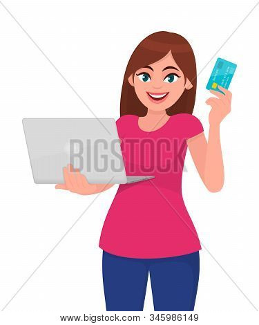 Trendy Young Woman Holding Laptop Computer And Showing Credit, Debit Or Atm Card. Stylish Girl Using