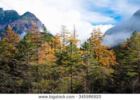 Close Up Mountain Range In Autumn With Clouds Blue And White Sky In Kamikochi National Park Focus On