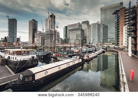 New Buildings Are Being Constructed In Canary Wharf, View From Poplar Dock Marina, In London, Uk