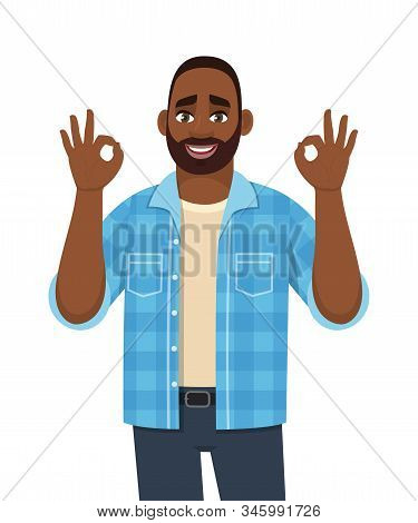 Trendy Young African Man Showing Okay, Cool Gesture Sign. Successful Black Person Making Ok, Good Sy