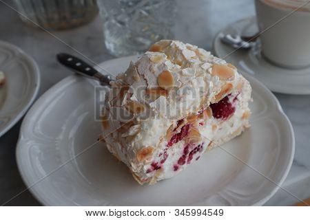 Dessert With Whipped Cream. Pavlova Dessert On A Plate.  Fork Stuck In Dessert. Piece Of Homemade De