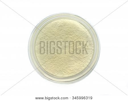 Creamer, Coffee Whitener, Non-dairy Creamer In A Glass Bottle Top View On White Background