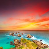 Nugget point. Coastal view at sunset poster