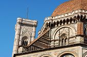 Duomo Santa Maria del Fiore or Florence Cathedral detail of Brunelleschi's dome and Giotto bell tower against the blue sky. poster