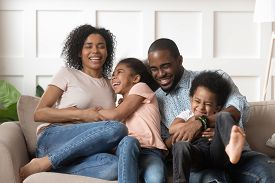 Smiling Black Family With Kids Having Fun At Home.