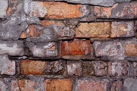 Old Brick Wall Texture Background Close-up. Stock Photo Of A Destroyed Wall.