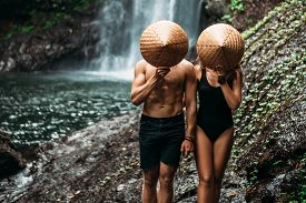 The Couple Travels The World. Vacation In Asia. A Couple In Love On A Waterfall. Man And Woman In Co