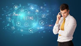 Businessman thinking in front of technology related icons and TESTING inscription, modern technology concept