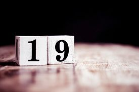 Number 19 Isolated On Dark Background- 3d Number Nineteen Isolated On Vintage Wooden Table