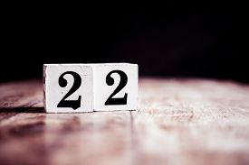 Number 22 Isolated On Dark Background- 3d Number Twenty Two Isolated On Vintage Wooden Table