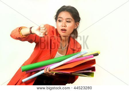 Business Woman Holding Folders And Papers Is  Hastily .
