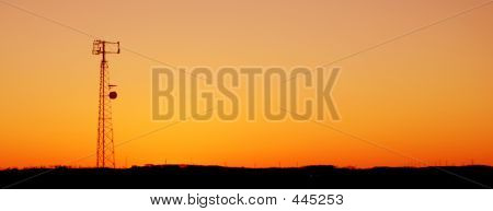 Orange Cell Tower Silhouette