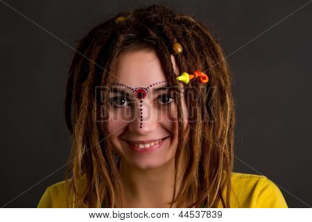 Woman With Dreadlocks  On A Gray Background