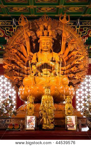 Golden Wood Statue of Kuan Yin with 1000 hands poster