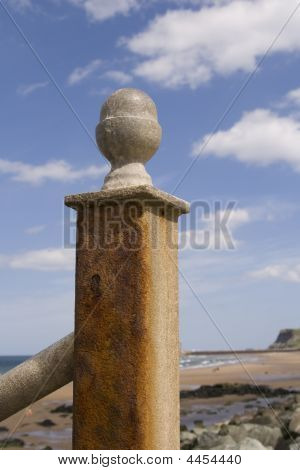 Rusted Metal Handrail At Steps To Beach