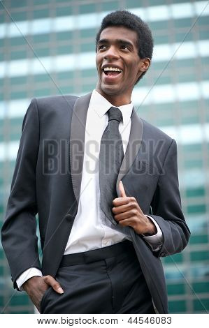 Portrait Of A Happy African American Businessman Smiling Outside