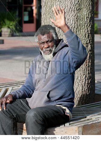 Elderly Homeless Man Waving