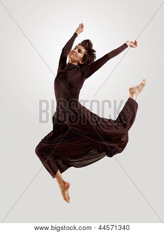 Girl in dark dress dancing