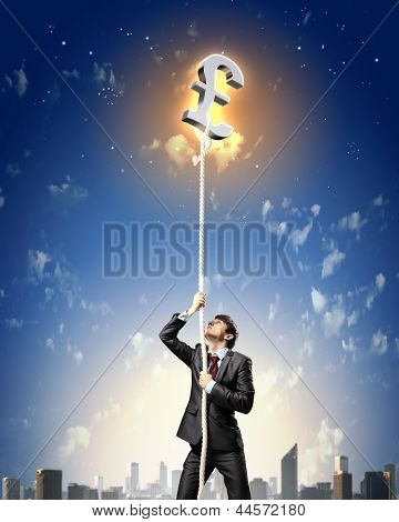 Image of businessman climbing rope attached to pound sign poster