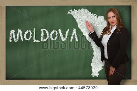 Teacher Showing Map Of Moldova On Blackboard