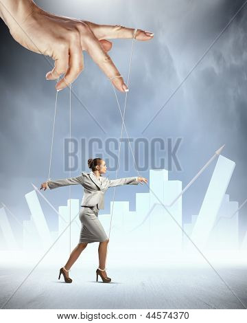 Business woman marionette