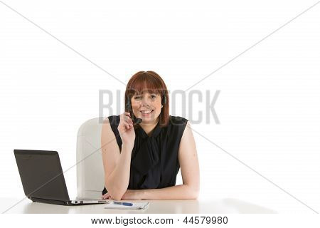 Smiling Receptionist Wearing A Headset