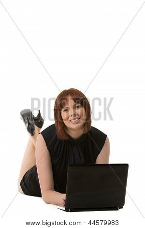 Relaxed Woman Using Her Laptop On The Floor
