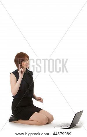 Woman Kneeling Chatting On Her Mobile