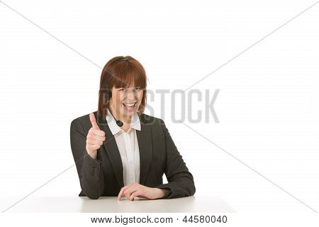 Happy Woman In A Headset Giving A Thumbs Up