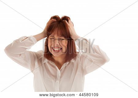 Attractive young frustrated woman tearing at her hair and gnashing her teeth in desperation head and shoulder portrait isolated on white poster