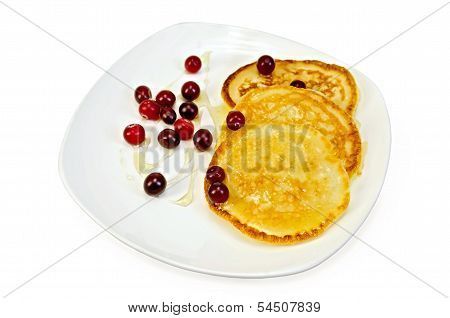Flapjacks With Cranberry And Honey In A Plate