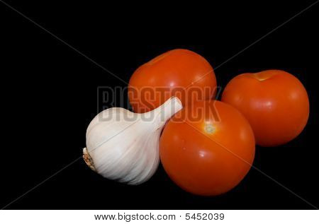 Garlic And Tomatoes On Black With Clipping Path