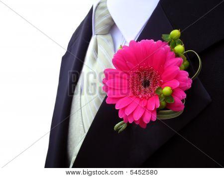 Pink Gerbera Daisy Boutonniere On Groomsman At Wedding