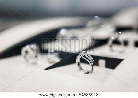 Close up of collection of rings in the showcase of jeweler's shop