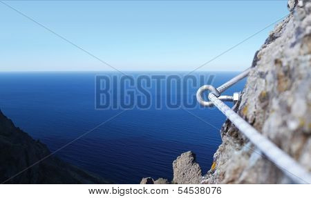 Iron Piton In A Granite Rock With Rope